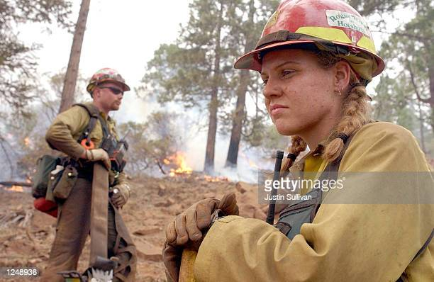 O'BRIEN OR AUGUST 4 Rogue River Hot Shots Megan Kruse and Jason Barber take a break after igniting a burnout in the Siskiyou National Forest August 4...