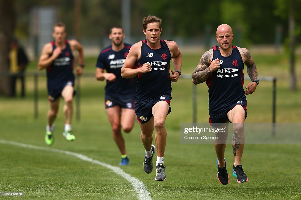 Rohan Bail and Nathan Jones of the Demons sprint during a Melbourne Demons AFL training session at Gosch's Paddock on November 5 2014 in Melbourne...