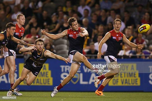 Rohan Bail of the Demons kicks the ball for a goal during the round one AFL NAB Challenge Cup match between the Richmond Tigers and the Melbourne...