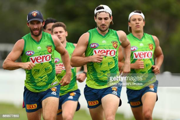 Rohan Bewick and Sam Mayes run during the Brisbane Lions AFL preseason training session at Yeronga on December 11 2017 in Brisbane Australia