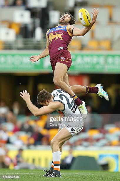 Rohan Bewick of the Lions attempts a mark over Heath Shaw of the Giants during the round 17 AFL match between the Brisbane Broncos and the Greater...