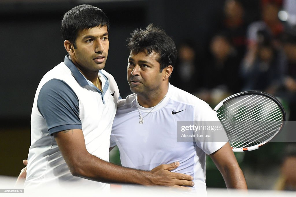<a gi-track='captionPersonalityLinkClicked' href=/galleries/search?phrase=Rohan+Bopanna&family=editorial&specificpeople=571696 ng-click='$event.stopPropagation()'>Rohan Bopanna</a> and <a gi-track='captionPersonalityLinkClicked' href=/galleries/search?phrase=Leander+Paes&family=editorial&specificpeople=215327 ng-click='$event.stopPropagation()'>Leander Paes</a> of India celebrate after winning men's doubles first round match against Tatsuma Ito and Go Soeda of Japan on day three of Rakuten Open 2014 at Ariake Colosseum on October 1, 2014 in Tokyo, Japan.