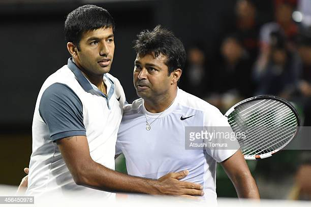Rohan Bopanna and Leander Paes of India celebrate after winning men's doubles first round match against Tatsuma Ito and Go Soeda of Japan on day...