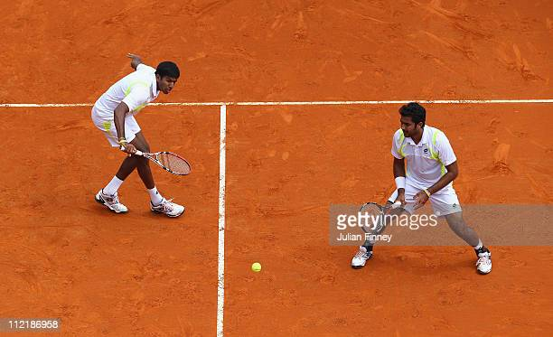 Rohan Bopanna of India and AisamUlHaq Qureshi of Pakistan in action in their doubles match against Eric Butorac of USA and Jean Julien Rojer of...