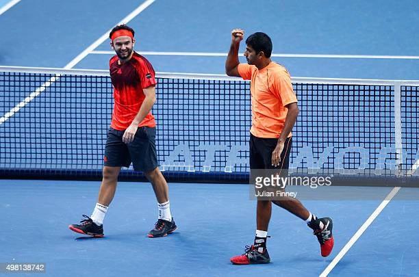 Rohan Bopanna of India and Florin Mergea of Romania celebrate defeating Ivan Dodig of Croatia and Marcelo Melo of Brazil in the doubles semi final...