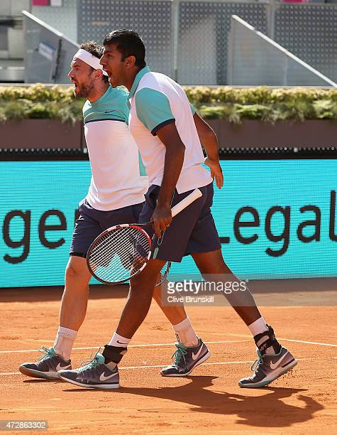 Rohan Bopanna of India and Florin Mergea of Romania celebrate match point after their three set victory against Marcin Matkowski of Poland and Nenad...