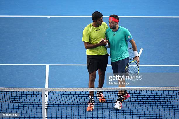 Rohan Bopanna of India and Florin Mergea of Romania celebrate winning their first round match against Omar Jasika of Australia and Nick Kyrgios of...