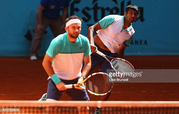 Rohan Bopanna of India and Florin Mergea of Romania in action against Marc Lopez and Marcel Granollers of Spain in their doubles semi final match...