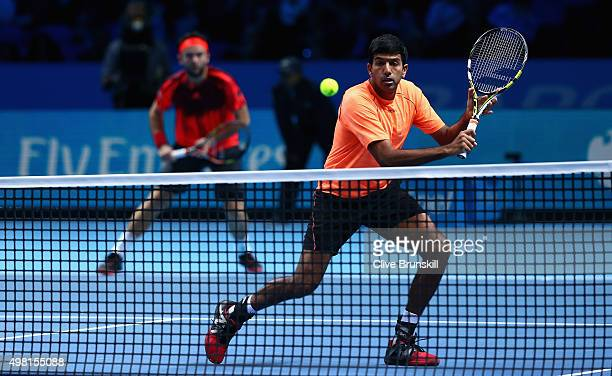 Rohan Bopanna of India and Florin Mergea of Romania in action against Ivan Dodig of Croatia and Marcelo Melo of Brazil during the men's doubles semi...
