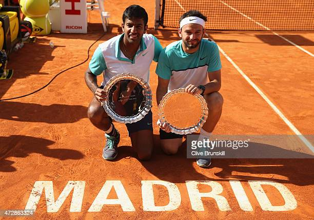 Rohan Bopanna of India and Florin Mergea of Romania with their winners trophies after their three set victory against Marcin Matkowski of Poland and...
