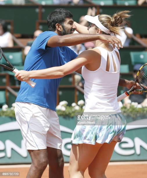 Rohan Bopanna of India and Gabriela Dabrowski of Canada celebrate after their victory over AnnaLena Groenefeld of Germany and Robert Farah of...