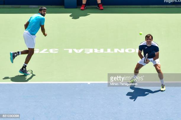 Rohan Bopanna of India and Ivan Dodig of Croatia compete in a doubles match against PierreHugues Herbert and Nicolas Mahut of France during day ten...