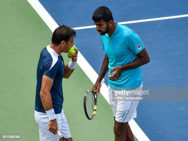 Rohan Bopanna of India and Ivan Dodig of Croatia discuss their strategy in their doubles match against PierreHugues Herbert and Nicolas Mahut of...