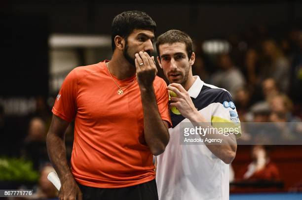 Rohan Bopanna of India and Pablo Cuevas of Uruguai in action against Marcelo Demoliner of Brazil and Sam Querrey of USA during Erste Bank Open 500...