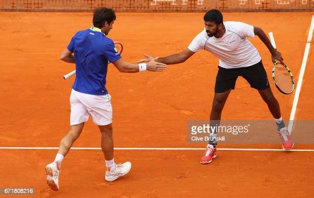 Rohan Bopanna of India and Pablo Cuevas of Uruguay celebrate a point against Feliciano Lopez and Marc Lopez of Spain in the doubles final on day...