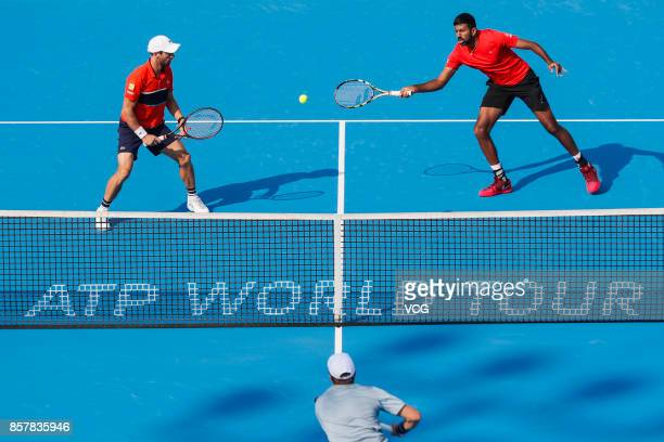 Rohan Bopanna of India and Pablo Cuevas of Uruguay compete during the Men's doubles quarterfinal match against Henri Kontinen of Finland and John...