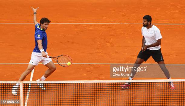 Rohan Bopanna of India and Pablo Cuevas of Uruguay in action against Feliciano Lopez and Marc Lopez of Spain in the doubles final on day eight of the...