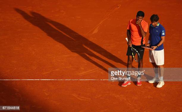 Rohan Bopanna of India and Pablo Cuevas of Uruguay play against Romain Arneodo of Monaco and Hugo Nys of France in their semi final round doubles...