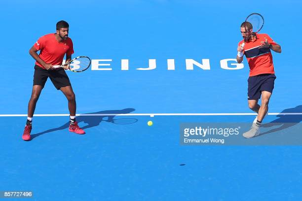 Rohan Bopanna of India and Pablo Cuevas of Uruguay return a shot against Henri Kontinen of Finland and John Peers of Australia during during their...