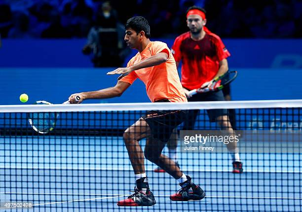 Rohan Bopanna of India plays a forehand partnering Florin Mergea of Romania in their men's doubles match against John Peers of Australia and Jamie...