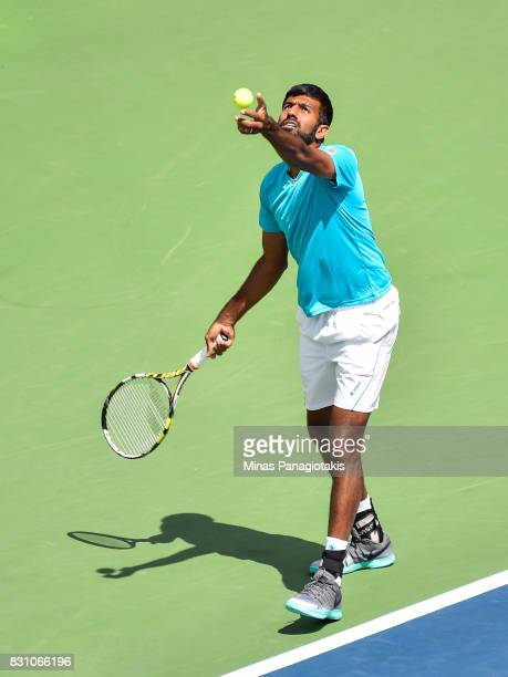 Rohan Bopanna of India serves during a doubles match against PierreHugues Herbert and Nicolas Mahut of France on day ten of the Rogers Cup presented...