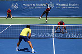 Rohan Bopanna of India serves over Florin Mergea of Romania during their doubles match against Ivan Dodig of Croatia and Marcelo Melo of Brazin on...