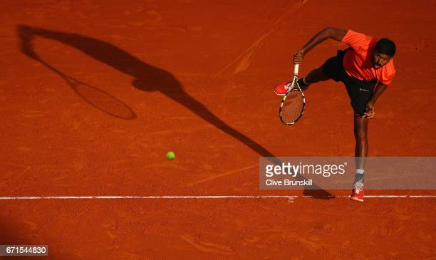 Rohan Bopanna of India serves play against Romain Arneodo of Monaco and Hugo Nys of France in their semi final round doubles match on day seven of...