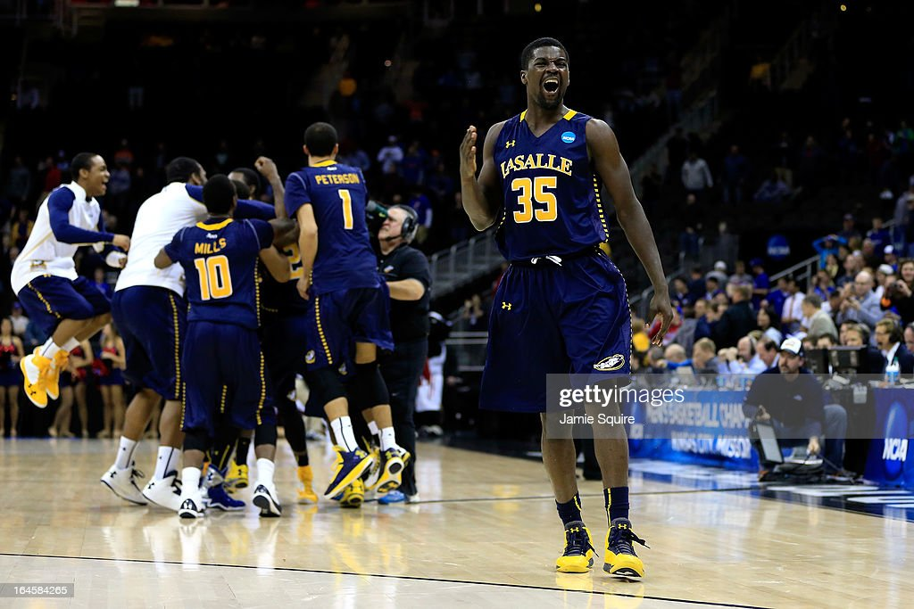 Rohan Brown #35 of the La Salle Explorers celebrates with his teammates after they won 76-74 against the Mississippi Rebels during the third round of the 2013 NCAA Men's Basketball Tournament at Sprint Center on March 24, 2013 in Kansas City, Missouri.