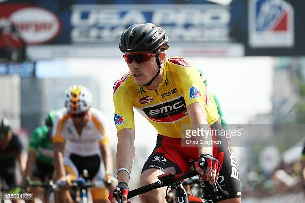 Rohan Dennis of Australia riding for BMC Racing crosses the finish line after winning the overall leader's jersey during stage seven from Golden to...