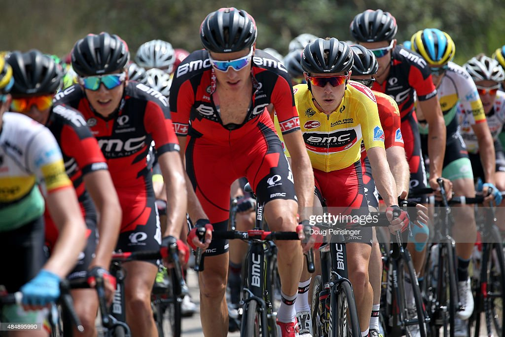 Rohan Dennis of Australia riding for BMC Racing rides under the protection of his teammates as he defends the overall race leader's yellow jersey...