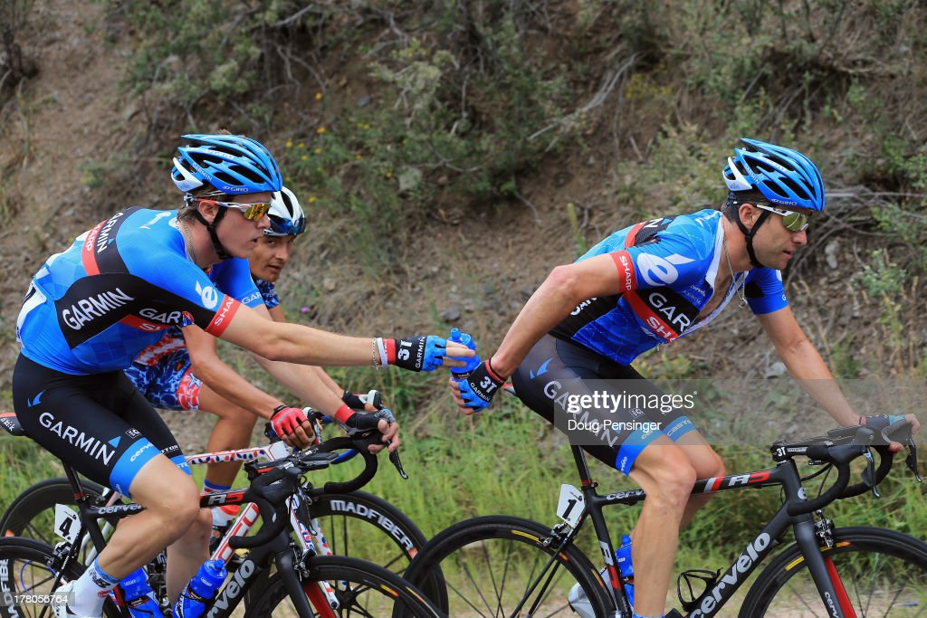 <a gi-track='captionPersonalityLinkClicked' href=/galleries/search?phrase=Rohan+Dennis&family=editorial&specificpeople=4872676 ng-click='$event.stopPropagation()'>Rohan Dennis</a> of Australia riding for Garmin-Sharp delivers beverages to teammate <a gi-track='captionPersonalityLinkClicked' href=/galleries/search?phrase=Christian+Vande+Velde&family=editorial&specificpeople=2841213 ng-click='$event.stopPropagation()'>Christian Vande Velde</a> of the USA riding for Garmin-Sharp during stage six of the 2013 USA Pro Challenge from Loveland to Fort Collins on August 24, 2013 in Loveland, Colorado.