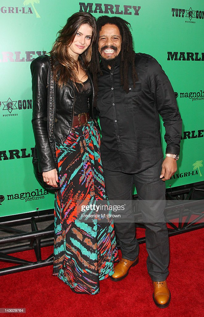 Rohan Marley (R) and his guest attend the Premiere of Magnolia Pictures' 'Marley' at the ArcLight Hollywood on April 17, 2012 in Hollywood, California.
