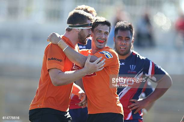 Rohan O'Regan of the Country Eagles celebrates with a team mate after scoring a try during the NRC Semi Final match between the NSW Country Eagles...