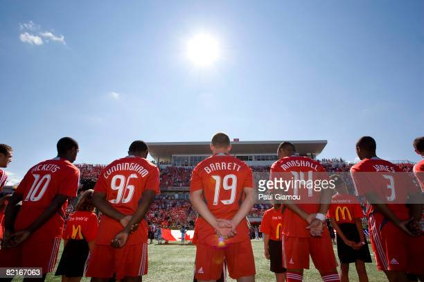 Rohan Ricketts Jeff Cunningham Chad Barrett Tyrone Marshall and Julius James of Toronto FC stand for the national anthems before the match against...