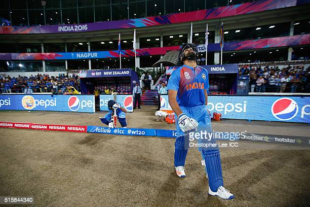 Rohi Sharma of India and Shikhar Dhawan of India walk out onto the pitch to open the batting during the ICC World Twenty20 India 2016 Group 2 match...