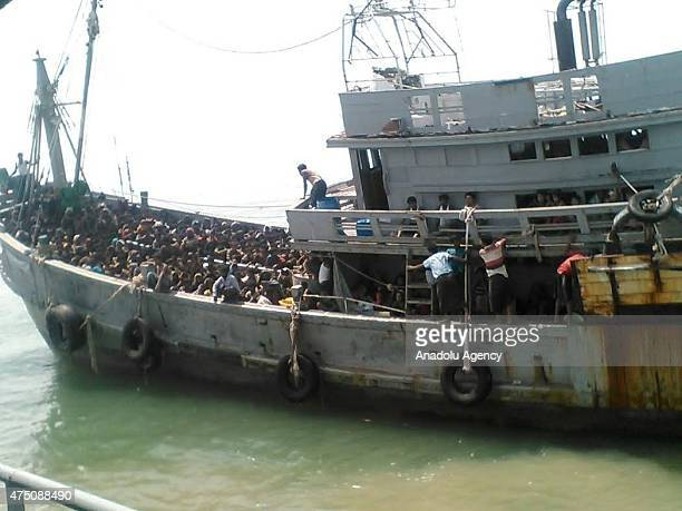 Rohingya and Bangladeshi migrants are seen after Myanmar's navy seizes a boat with 727 migrants off the country's southern coast near the city of...