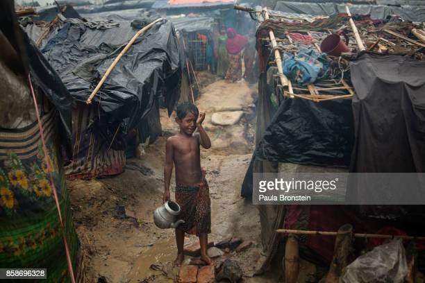 Rohingya boy cries as monsoon rains continue to batter the area causing more difficulties October 7 Thainkhali camp Cox's Bazar Bangladesh Well over...