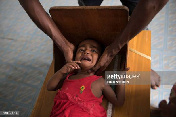 Rohingya boy gets measured at the Action Against Hunger in the Out Patient Therapeutic program on September 24 2017 in Amtola Cox's Bazar Bangladesh...
