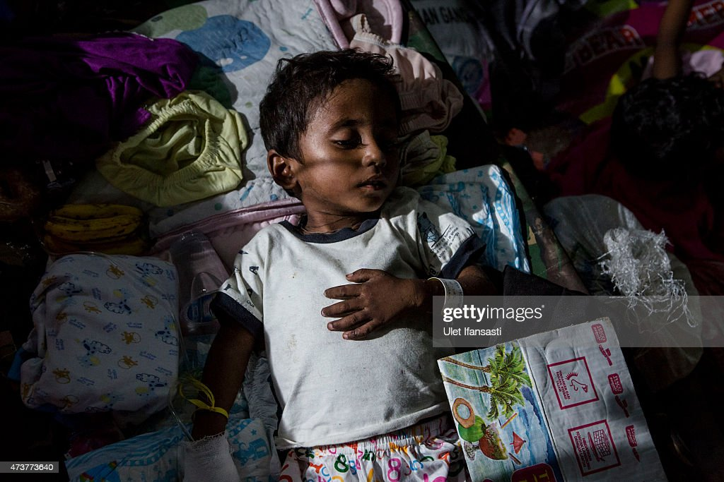 A Rohingya boy rest inside at a temporary shelter on May 17, 2015 in Kuala Langsa, Aceh province, Indonesia. Hundreds of Myanmar's Rohingya refugees arrived in Indonesia on May 15, many requiring medical attention. Thousands more are believed to still be stranded at sea reportedly with no country in the region willing to take them in. Myanmar's Rohingya Muslim community have long been persecuted and marginalized by Myanmar's mostly Buddhist population.