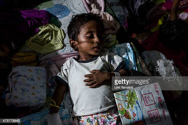 Rohingya boy rest inside at a temporary shelter on May 17 2015 in Kuala Langsa Aceh province Indonesia Hundreds of Myanmar's Rohingya refugees...