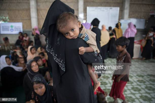 Rohingya boy waits for treatment at the Action Against Hunger in the Out Patient Therapeutic program on September 24 2017 in Amtola Cox's Bazar...