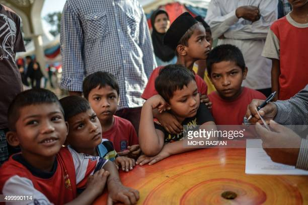 Rohingya boys from Myanmar living in Malaysia take part in a mass circumcision ceremony at a mosque in Ampang in the suburbs of Kuala Lumpur on...