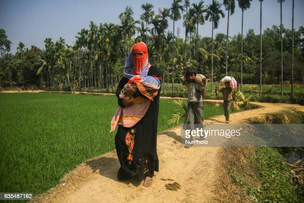 Rohingya carring the packs of humanitarian aid from distribution centre to bring back home at their makeshift Refugee Camp in Kutupalong Bangladesh...