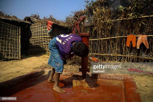 A Rohingya child drink a water from water pump at the makeshift Balu Khali Rohingya refugee camp on February 15 2017 in Bangladesh Almost 2000...