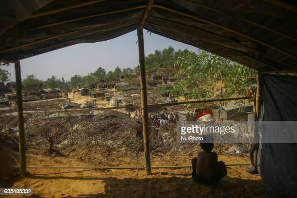 A Rohingya child in seen sit inside the makeshift Balu Khali Rohingya refugee camp on February 15 2017 in Bangladesh Almost 2000 thousand Rohingya...