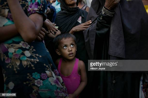 COX'S BAZAR BANGLADESH SEPTEMBER 21 A Rohingya child is caught in a crowd waiting for aid near a refugee camp on September 21 2017 in Cox's Bazar...
