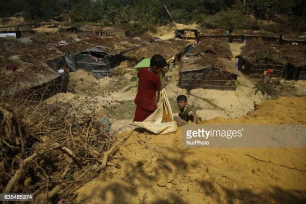 A Rohingya child play at the hill inside the makeshift Balu Khali Rohingya refugee camp on February 15 2017 in Bangladesh Almost 2000 thousand...