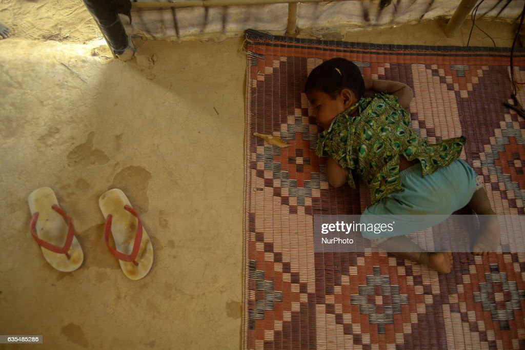 A Rohingya child sleep inside the makeshift Balu Khali Rohingya refugee camp on February 15, 2017 in Bangladesh. Almost 2000 thousand Rohingya family arrived at Balu Kali camp a month ago living in makeshift camp after conflict in Rakhine state started October last year flee to Bangladesh. More than 31 Non-goverment organisations (NGO) include Mapim and Kelab Putra 1 Malaysia from Malaysia, Indonesia, China, France, Germany, and United States joint forces bringing almost 2300 tonne of humanitarian goods include medicine, food, cooking oil and cloth were sending to ethnic minority Rohingya in Yangon and Teknaf.
