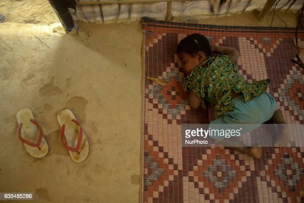 A Rohingya child sleep inside the makeshift Balu Khali Rohingya refugee camp on February 15 2017 in Bangladesh Almost 2000 thousand Rohingya family...
