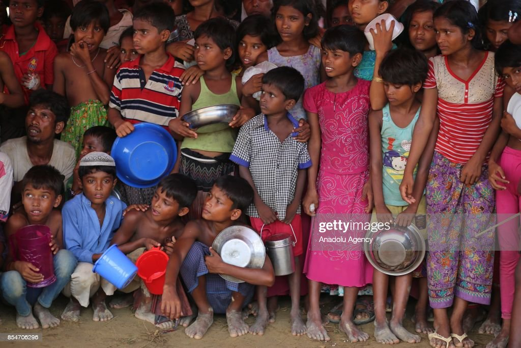 Rohingya children wait for food aid near the Thengkhali makeshift camp in Teknaff, Bangladesh on September 27, 2017. Violence erupted in Myanmars Rakhine state on Aug. 25 when the countrys security forces launched an operation against the Rohingya Muslim community. It triggered a fresh influx of refugees towards neighboring Bangladesh, though the country sealed off its border to refugees.